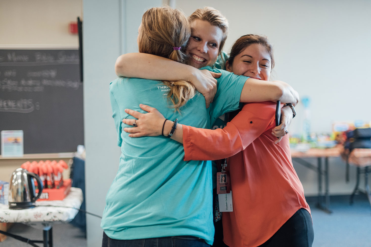 women hugging each other and smiling