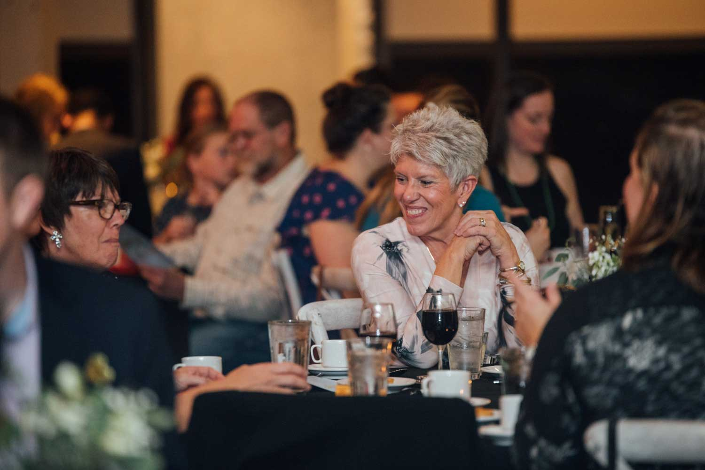 women smiling at dinner table