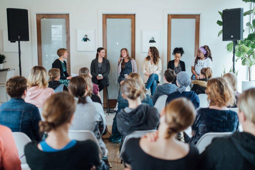 Women talking in front of crown