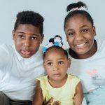 three kids smiling at camera