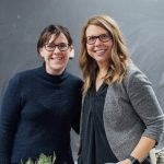 two women smiling at camera