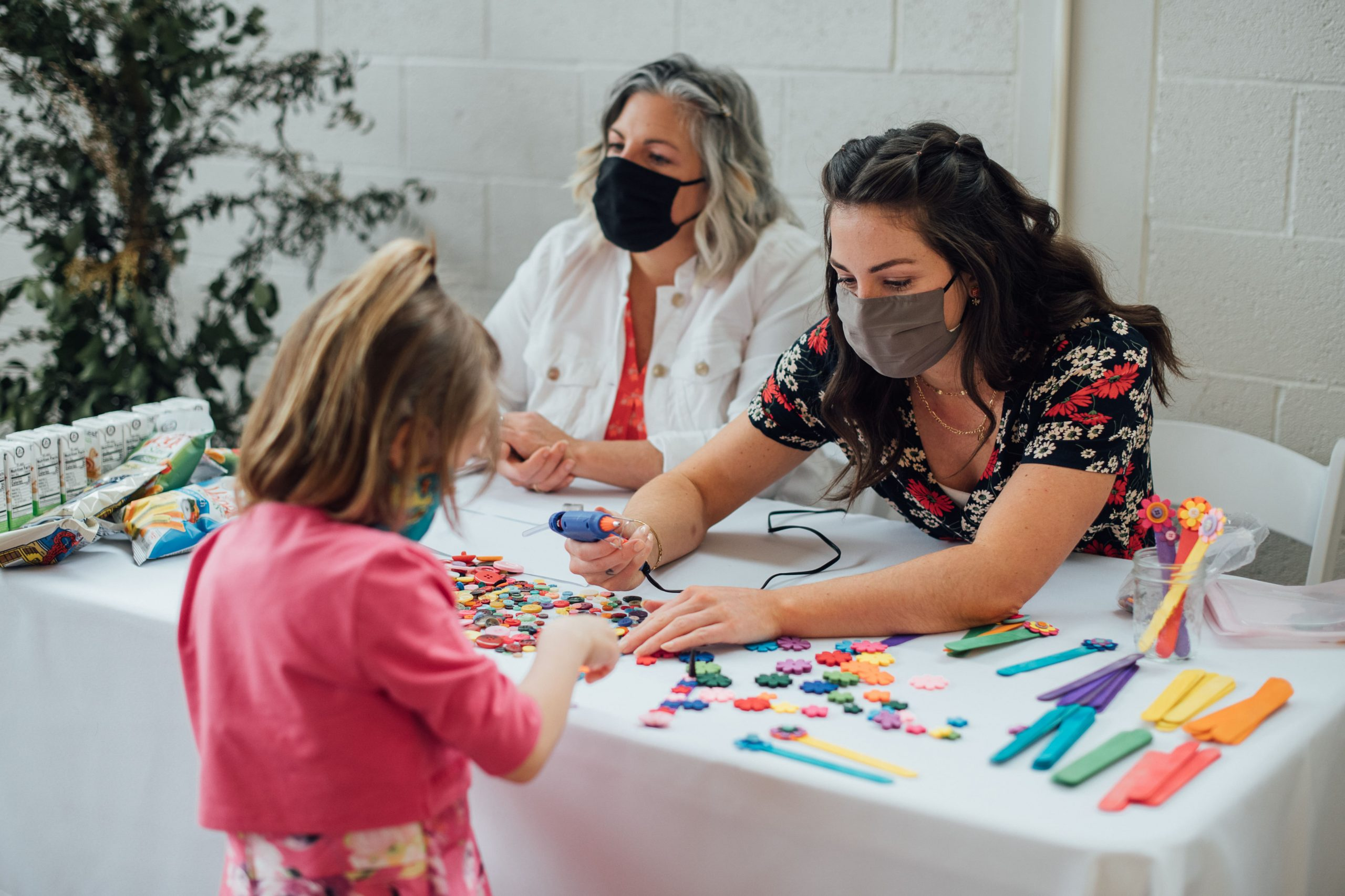Volunteers doing crafts with child