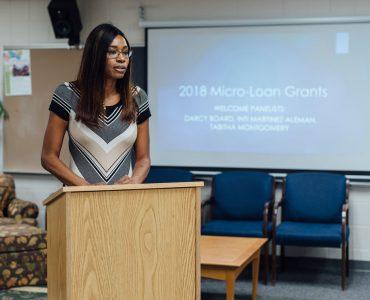 women standing at podium